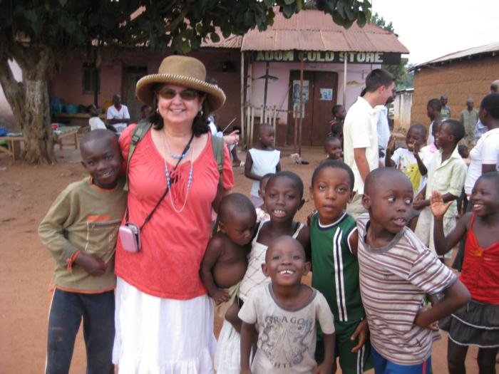 Mary Barber with children in Awaso Village in Ghana, Africa.